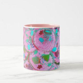 Taza rosada de las magdalenas