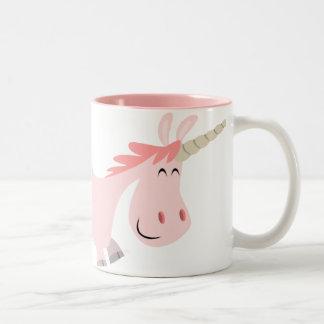 Taza rosada del unicornio del dibujo animado