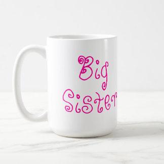 Taza rosada linda de la hermana grande