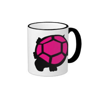 Taza rosada y negra de la tortuga