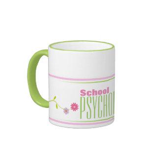 Taza rosada y verde del psicólogo de la escuela de