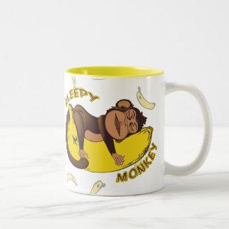 Taza soñolienta del mono
