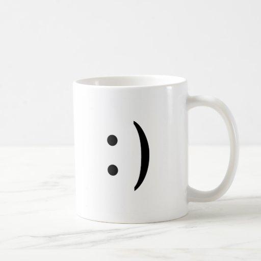 Taza sonriente de la cara