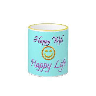 Taza sonriente de la cara de la vida feliz feliz d