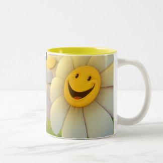 Taza sonriente de las margaritas