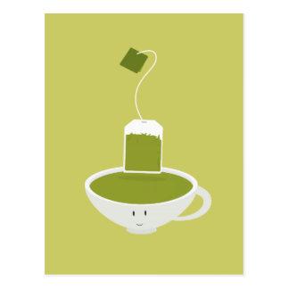 Taza sonriente de té verde con la bolsita de té tarjeta postal