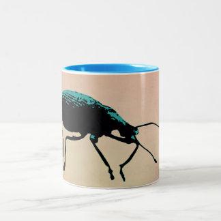 Taza suave del escarabajo