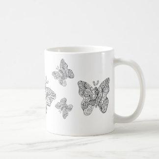 Taza tatuada de la mariposa
