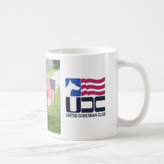 Taza unida del club de Dobe con el logotipo