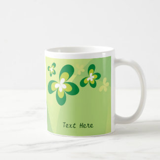 Taza verde de la mariposa