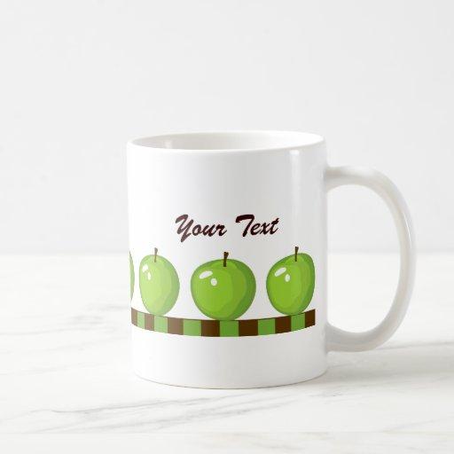 Taza verde de las manzanas