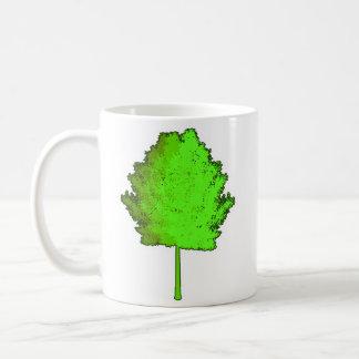 Taza verde del árbol