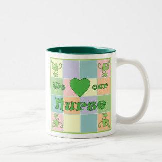Taza (verde) del remiendo de la enfermera
