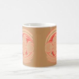 Tazas anaranjadas del diseño del remolino