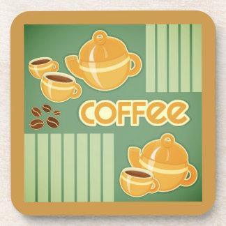 Tazas de café, pote del café y granos de café posavasos