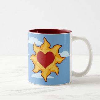 Tazas lindas de Sun y del corazón