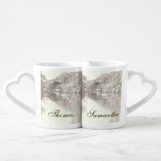 Tazas románticas de los amantes de la pasarela