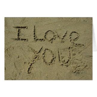 Te amo escrito en arena felicitacion