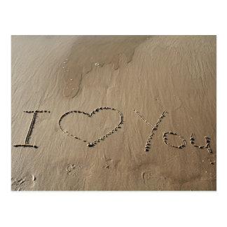 Te amo escrito en la arena postales