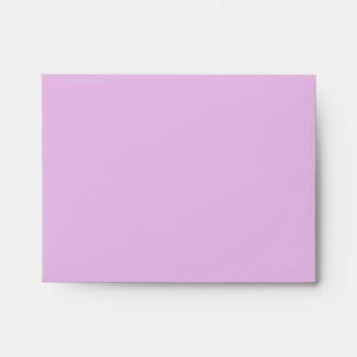 Té y rosas púrpuras sobres