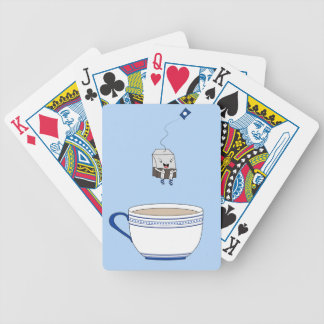 Tea bag jumping in cup bicycle playing cards