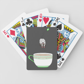 Tea bag jumping in cup of tea bicycle playing cards