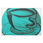 tea cup in green placemat