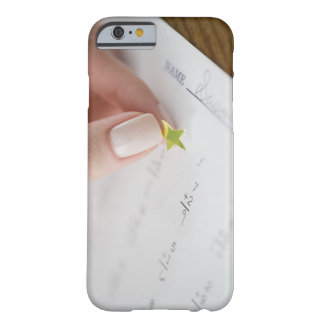 Teacher affixing gold star to math worksheet barely there iPhone 6 case