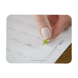 Teacher affixing gold star to math worksheet rectangular photo magnet