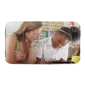 Teacher and school child working in classroom iPhone 3 cases