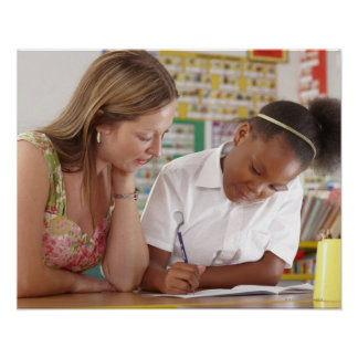 Teacher and school child working in classroom poster