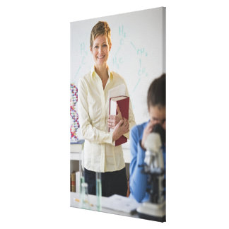 Teacher and student in science lab canvas print
