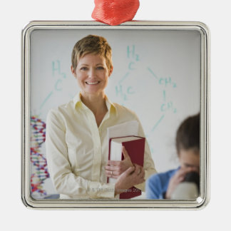 Teacher and student in science lab metal ornament