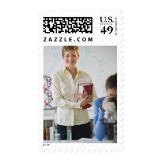 Teacher and student in science lab postage stamps