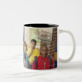 Teacher and students in school hallway Two-Tone coffee mug