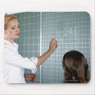 teacher and young girl in front of blackboard in mouse pad