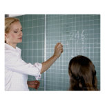 teacher and young girl in front of blackboard in poster