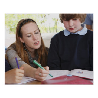 teacher assisting child with work in classroom poster