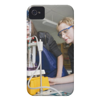 Teacher assisting student in laboratory iPhone 4 Case-Mate case