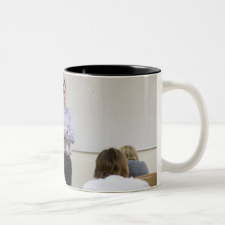 Teacher at front of class, children working hard Two-Tone coffee mug