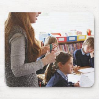 teacher explaining lesson to schoolchildren mousepad