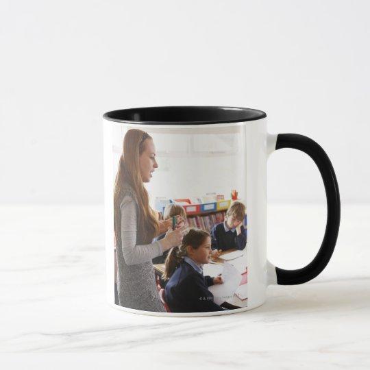 teacher explaining lesson to schoolchildren mug