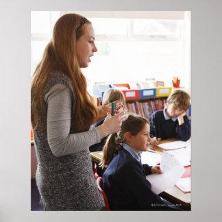 teacher explaining lesson to schoolchildren poster