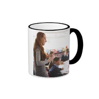 teacher explaining lesson to schoolchildren ringer coffee mug
