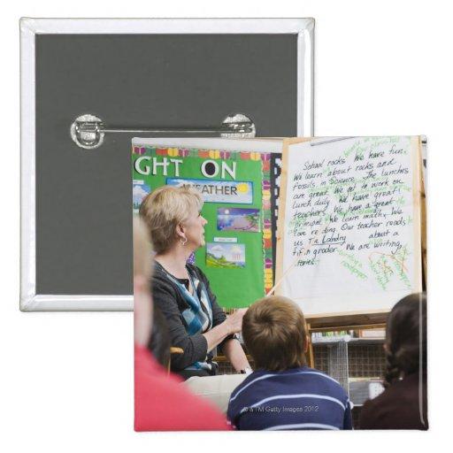 Teacher giving classroom presentation to pinback button