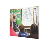 Teacher giving classroom presentation to gallery wrapped canvas