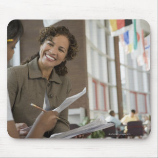 Teacher giving paperwork to student mouse pad