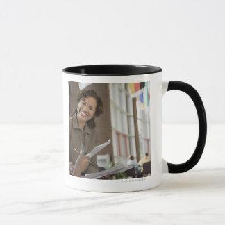 Teacher giving paperwork to student mug