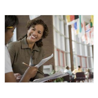 Teacher giving paperwork to student postcard