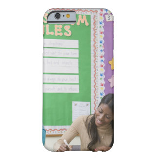 Teacher grading girls paper in classroom barely there iPhone 6 case